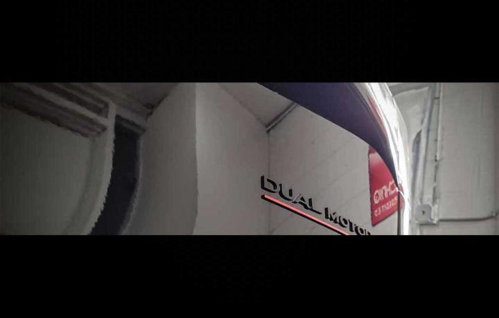 black tesla dual motor emblem